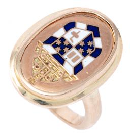Sale 9124 - Lot 439 - A 9CT GOLD ENAMELLED SIGNET RING; featuring an engraved mitre above a shield inlaid with blue and white enamel, size H, top 21 x 15m...