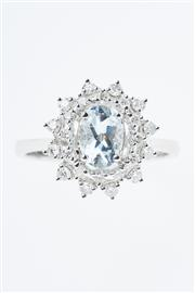 Sale 8299J - Lot 322 - AN 18CT WHITE GOLD AQUAMARINE AND DIAMOND CLUSTER RING; centring an approx. 0.76ct aquamarine to a double border of round brilliant...