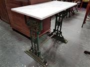 Sale 8728 - Lot 1005 - Possibly Victorian Cast Iron Garden Table, with white marble top, the painted green base with twist stretcher