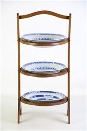 Sale 8905S - Lot 680 - Three tiered plate stand holding three Chinese plates. Height 51cm