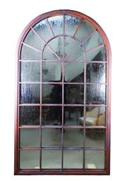 Sale 8980J - Lot 62 - A large arch form iron window frame with aged weathered copper finish  and fitted with mirrors, height 180 x 104cm