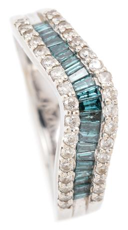 Sale 9128J - Lot 8 - A 14CT WHITE GOLD BLUE AND WHITE DIAMOND RING; wave ring channel set with tapered baguette cut treated blue diamonds flanked by 34 r...