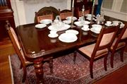 Sale 8107B - Lot 18 - A Victorian style Mahogany extension dining table with three spare leaves and on turned fluted legs to castors. Height 76cm, Length...