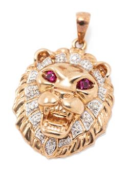 Sale 9169 - Lot 372 - A 9CT GOLD DIAMOND AND GEMSET LION PENDANT; eyes set with 2 round cut rubies and surrounded by 4 round brilliant cut diamonds, size...