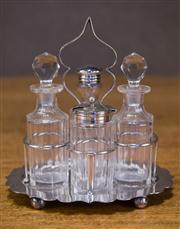 Sale 7379B - Lot 24 - An Edwardian English silver plate and cut crystal 4 bottle cruet stand. C. 1900