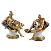 Sale 8000 - Lot 67 - A pair of Giuseppe Cappe gilded ceramic figures of a warrior La Guerra, and a scantily clad maiden in the classical style.