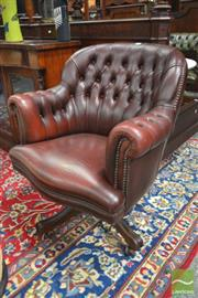 Sale 8282 - Lot 1047 - Brown Buttoned Leather Office Chair, with rolled arms & brass studs
