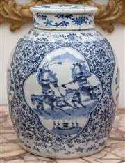 Sale 8435A - Lot 76 - A Chinese blue and white lidded jar with alternating scenes of warriors and birds amongst peonies, Kangxi mark, crack to cover, H 29...