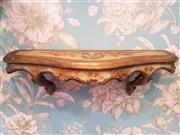 Sale 8500A - Lot 43 - A vintage Italian florentine demi lune wall shelf - Condition: Very Good - Measurements:  50cm length x 17cm deep x 16cm High