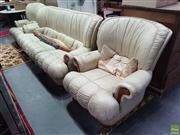 Sale 8601 - Lot 1069 - Cream Leather Upholstered Three Piece Lounge Suite incl. Pair of Armchairs & Three Seater Sofa