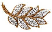 Sale 8937 - Lot 433 - AN 18CT TWO TONE GOLD DIAMOND BROOCH; branch design in yellow gold twisted wire forming 8 leaves set in white gold with a total of 8...