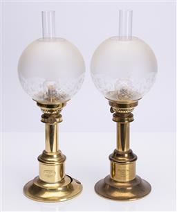 Sale 9185E - Lot 37 - A pair of gilt G.V Harnisch kerosene lamps with glass shades and flutes, with losses, Height 35cm