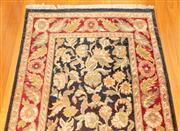 Sale 8863H - Lot 51 - A Robyn Cosgrove Persian runner with floral design on a black ground with red border, 360cm x 92cm