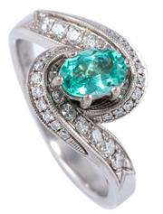Sale 8954 - Lot 368 - A PARAIBA TOURMALINE AND DIAMOND DRESS RING; featuring an oval cut Paraiba tourmaline of approx. 1.06ct of light blueish green colou...