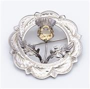 Sale 9015J - Lot 82 - A vintage Scottish hallmarked sterling silver brooch,Ward Brothers, Edinburgh 1960, the free form thistle set with a citrine, within...