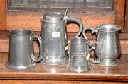 Sale 8015A - Lot 33 - A set of four pewter tankards including a lidded and crested example