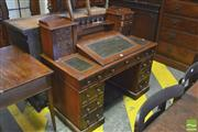 Sale 8390 - Lot 1064 - A Victorian Mahogany Dickens style Desk Twin Pedestal with gallery back, Wellington style upper drawers and a hinged writing surface...