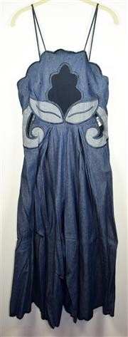 Sale 8460F - Lot 51 - An Alice McCall shoe string strap denim jumpsuit with embellished front, size 10