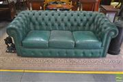 Sale 8267 - Lot 1050 - Moran Green Buttoned Leather Three Seater Chesterfield