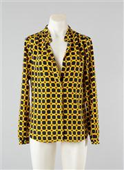 Sale 8740F - Lot 49 - A Michael Kors black and yellow chain print blouse with stand collar, size small