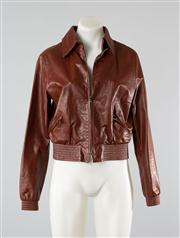 Sale 8740F - Lot 7 - Scanlan & Theodore brown leather jacket, size 12