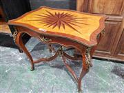 Sale 8976 - Lot 1083 - French Transitional Style Centre Table, with brass mounts, the star-burst top on blond burr field, on cabriole legs with stretcher b...