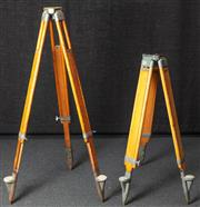 Sale 8984W - Lot 505 - A non matching pair of heavy duty timber surveyors tripods, the taller 130cm