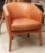 Sale 9060H - Lot 26 - A French style leather upholstered club chair with removable seat cushion and full leather upholstered legs to front and rear. Heig...