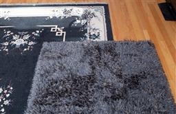 Sale 9190H - Lot 475 - A black rug with cream border and floral motif 327x240cm together with a Shaggy rug.