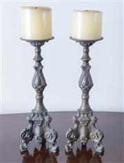 Sale 8800 - Lot 101 - A pair of bronze Continental pricket candle holders in the classical style with tripod base, H 30cm