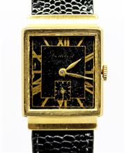 Sale 8402W - Lot 25 - VINTAGE CORTEBERT 18CT GOLD WRISTWATCH; black dial with painted golden Roman numerals, hands and subsidiary seconds in a curve case...