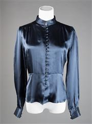 Sale 8499A - Lot 84 - A Tokito navy blue silk blouse, gatherd at shoulders and buttons down front with a firm high collar. Size: 8.