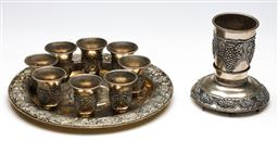 Sale 9246 - Lot 99 - A cast metal drinks suite consisting of a tray, eight shot glasses, one pouring implement and one pouring cup