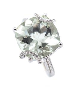Sale 9253J - Lot 415 - A SILVER GREEN AMETHYST AND DIAMOND COCKTAIL RING; 4 claw set with a cushion cut green amethyst of approx. 10.32ct to single cut dia...
