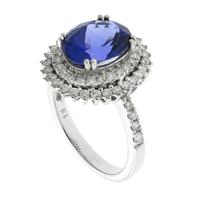 Sale 8221A - Lot 90 - 18ct White Gold Tanzanite and Diamond Cluster Ring; centering an approx 3.1ct tanzanite, two row boarder and shoulders surrounded wi...