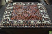 Sale 8335 - Lot 1019 - Vintage Probably Caucasian Wool Cushion, with hooked guls on red lattice field, but one reversed (80 x 65cm)