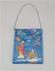 Sale 8499A - Lot 85 - A vintage Japanese light blue silk purse with silk lining and compartments with purse and mirror. Embroidered scene of Japanese woma...