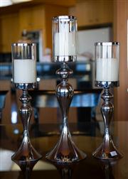 Sale 7984 - Lot 32 - A set of three chrome and glass raised candlesticks,