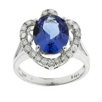 Sale 8221A - Lot 8 - 18ct White Gold Oval Tanzanite and Diamond Ring; centering an oval cut tanzanite estimated at 3ct, to heart shape surround set with...