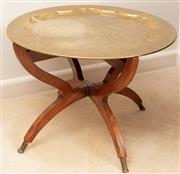 Sale 8926K - Lot 20 - An Inidan engraved brass tray top occasional table on folding base, D 57cm
