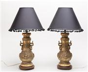 Sale 8716A - Lot 94 - A pair of heavy Chinese brass lamps. The neck with double ring handles above the ornately detailed body on a circular stepped base o...