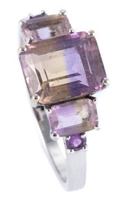 Sale 8946 - Lot 347 - A 9CT WHITE GOLD AMETRINE RING; set with 3 emerald cut ametrines totalling approx. 4.00ct with a small amethyst set at each shoulder...