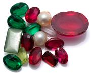 Sale 9083 - Lot 577 - A GROUP OF ASSORTED COLOURED STONES; mixed cut garnets, synthetics and pastes.