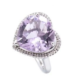 Sale 9253J - Lot 439 - A SILVER AMETHYST AND DIAMOND COCKTAIL RING; heart shaped top featuring a heart cut amethyst to surround set with 20 single cut diam...