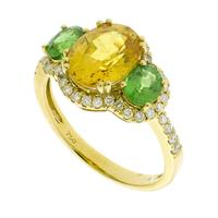 Sale 8221A - Lot 115 - 18ct Gold Sapphire Ring; centering an oval cut sapphire estimated at 2.63ct, adjacent to two green garnets totalling 0.84ct and a su...