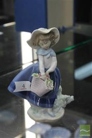 Sale 8256 - Lot 4 - Lladro Figure of a Girl Holding Flowers