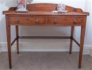 Sale 8800 - Lot 104 - A mahogany ladies writing desk with an arched galleried back, with two drawers and tapered legs, H 66 x W 106 x D 51cm