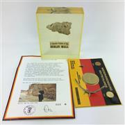 Sale 8618 - Lot 45 - Berlin Wall Fragment in perspex, with Reunification of Germany Coin and Wall display