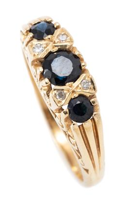 Sale 9182 - Lot 381 - A VICTORIAN STYLE 18CT GOLD SAPPHIRE AND DIAMOND RING; set across the top with 3 round cut blue sapphires between 4 single cut diamo...