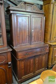 Sale 8520 - Lot 1023 - Good Regency Mahogany Secretaire Bookcase, with carved scroll top, four panel doors with broad cross-banding & fall-front drawer enc...